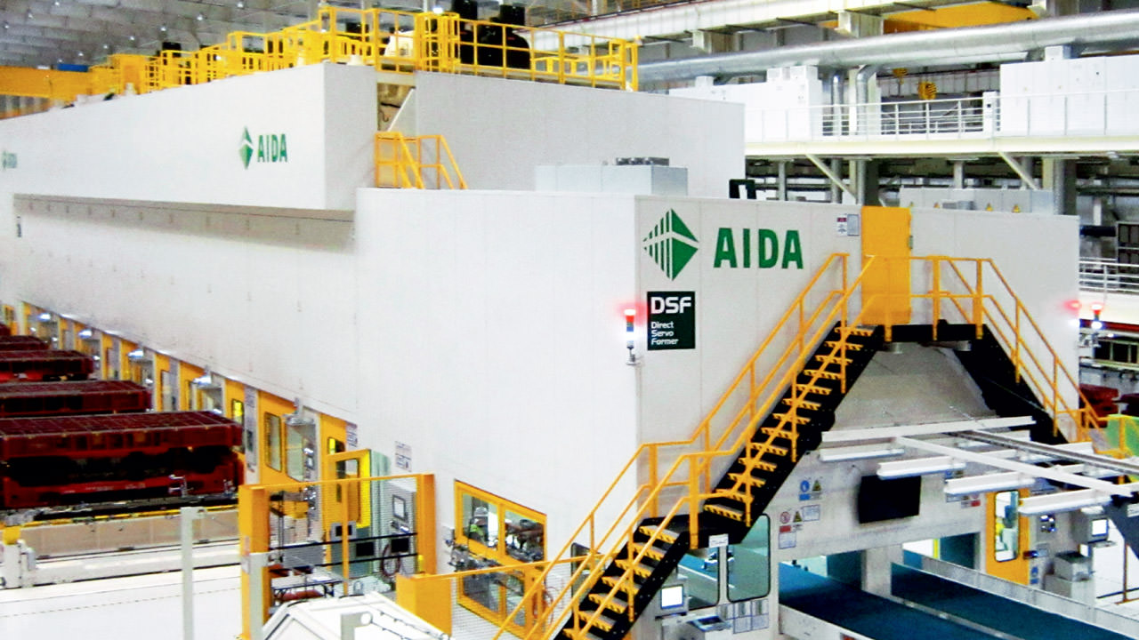 Tandem press line from Aida Engineering in an automotive production facility.