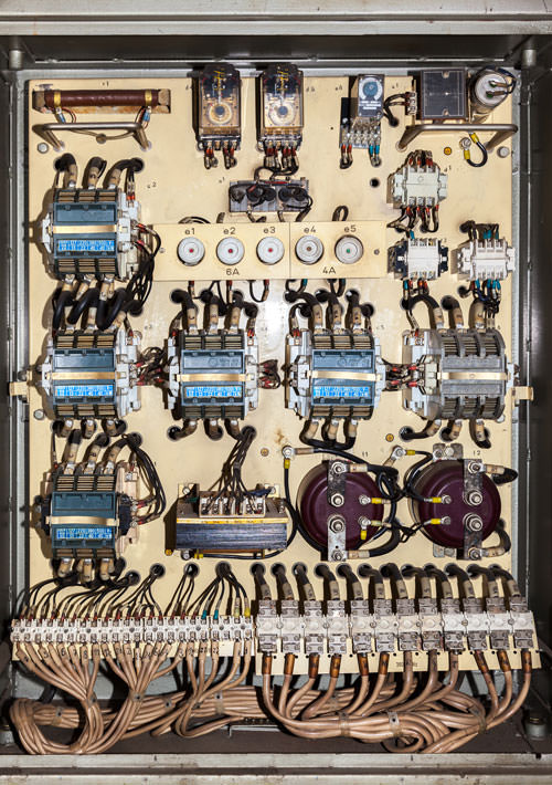 Old service panel with contactors and fuses.